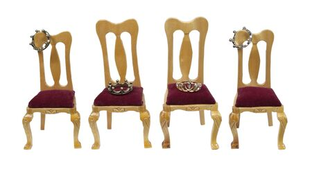 Royal family shown by wooden thrones with velvet seats with a variety of crowns - path included