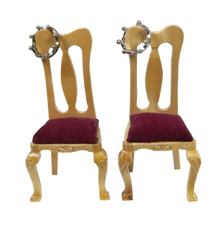 Crowned thrones with simple coronet crown designs on chairs with velvet seats
