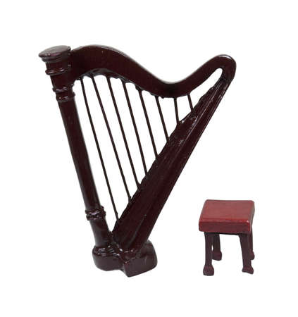 A stool and a harp which is a stringed musical instrument Stock Photo - 8764418