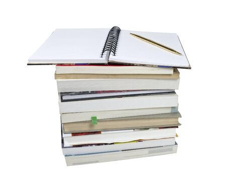 Stack of books and notebook placed open with a pen