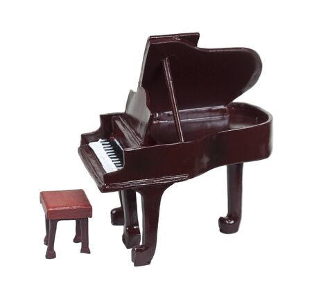 A traditional wooden and ivory grand piano  photo