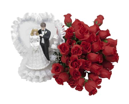 soft pedal: Bride in a white dress and groom wearing a tuxedo with a bouquet of roses - path included Stock Photo