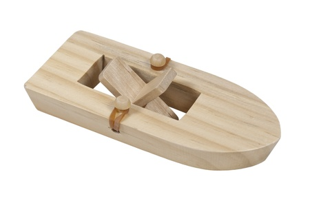 rubberband: Rubberband powered wooden paddle boat - path included Stock Photo