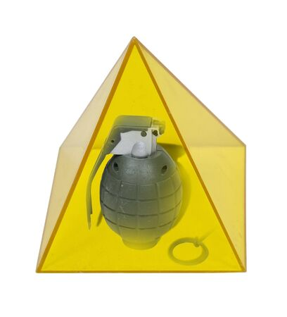 Egypt struggles shown by a grenade in a yellow pyramid  Imagens