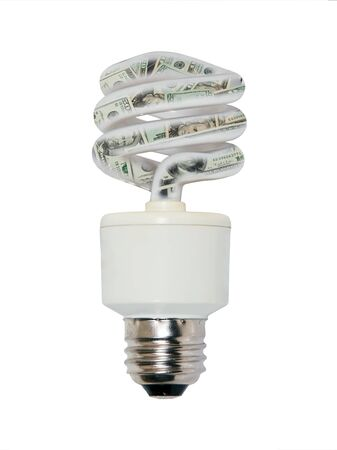 efficiently: Power savings shown by money inside a spiral light bulb used to light a room efficiently
