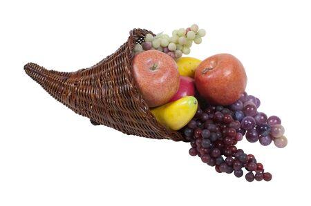 harvest cone cornucopia: Wicker horn cornucopia full of fruit which is symbolic for plentiful abundance - path included Stock Photo