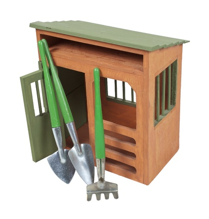 Wooden garden shed with tools for tending plants - path included