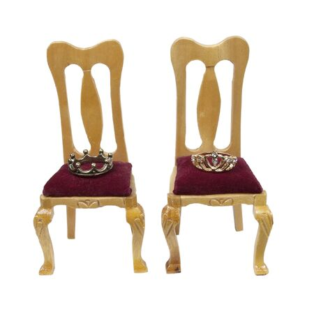 Thrones of the king and queen with velvet seats and royal crowns - path included photo
