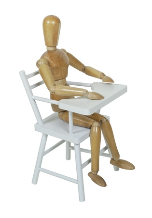 Sitting in a wooden high chair used when feeding babies and children  photo