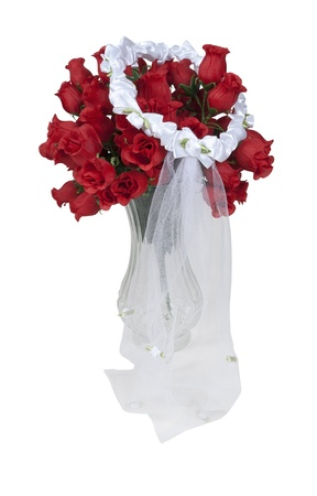 soft pedal: Lace veil with ribbons and tiny flowers on a bouquet of red roses in a vase