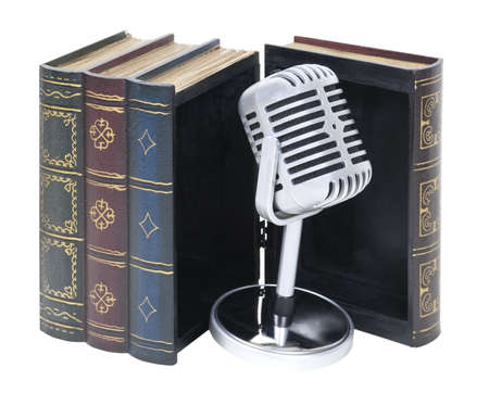 Audio books shown by a retro pill audio microphone in an open wooden book
