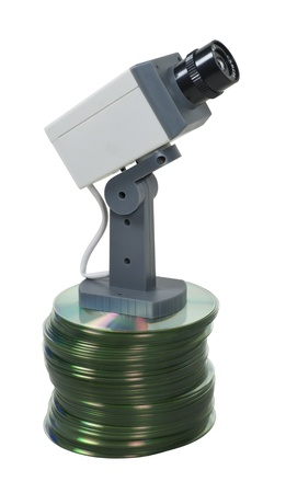 Information security shown by a security camera on a large stack of disks Stock Photo - 9445681