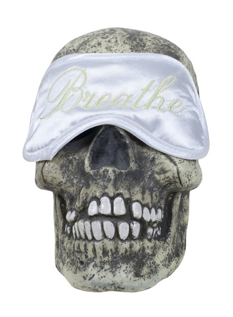 Sleep mask designed to keep the light out while taking a snooze on a skull - path included
