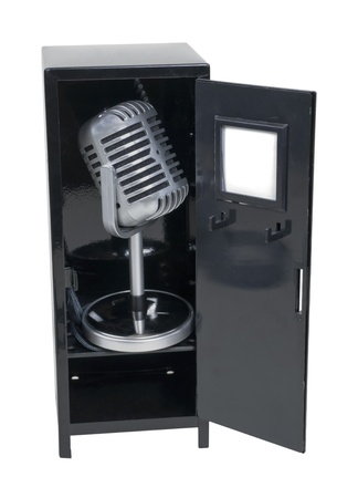 Sports announcements shown by a retro pill audio microphone in a metal locker - path included Stock Photo - 9514535