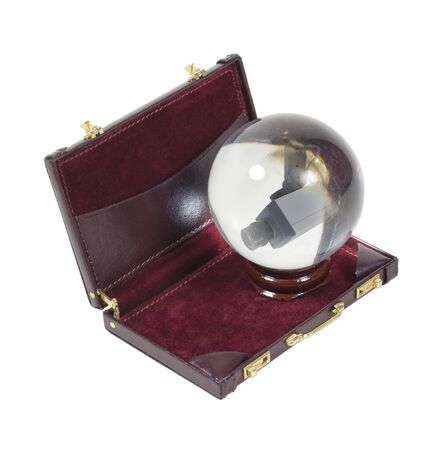 predicting: Predicting secure business shown by a security camera in a crystal ball in a briefcase