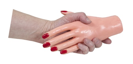 grasp: Anonymous business handshake shown by a person shaking hands with a rubber hand