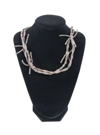 Black velvet neck form with a sharp barbed wired necklace - path included