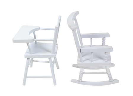 Seating for the stages of life shown by a wooden high chair for youth and a rocking chair for elderly - path included Stock Photo