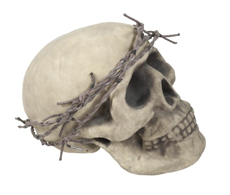 Skull with eye sockets and teeth wearing a crown made of barbed wire thorns - path included photo