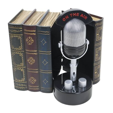 Story broadcasts shown by a retro pill audio microphone with an on the air banner inside a set of books - path included Stock Photo - 9635506