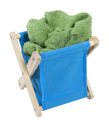 Blue laundry hamper full of dirty laundry - path included Stock Photo