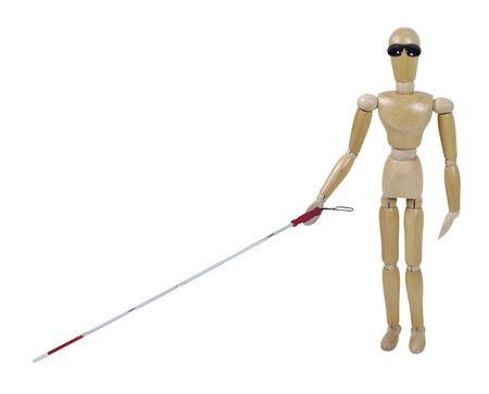 Visually challenged model with a white cane with caution stripe and blackout glasses - path included