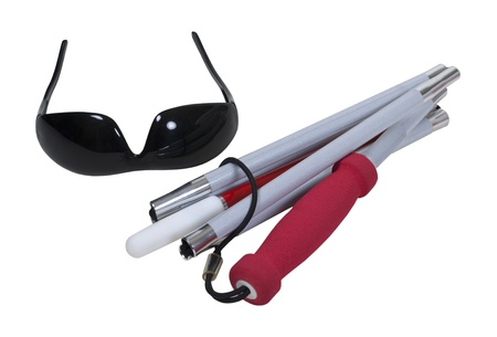 Compacted white cane with caution stripe and a pair of blackout glasses - path included Stock Photo - 9714819