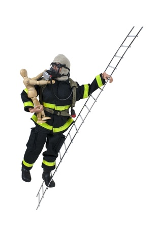 Fireman in protective gear used for fighting fires and saving lives on a ladder with a child - path included Stock Photo - 9714812