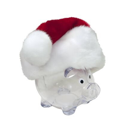 Santa funds shown by a traditional red with white trim Santa hat on a piggy bank for the holidays - path included photo