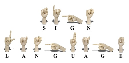 Sign Language spelled out in American Sign language is expressed with visible hand gestures for communication of the deaf photo