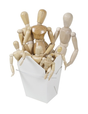 A group of wooden art models representing people in a folded take out box  Reklamní fotografie