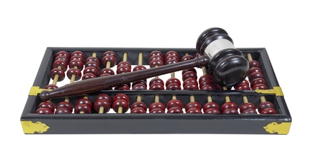 A wooden gavel on an abacus symbolizing law and accounting   Фото со стока