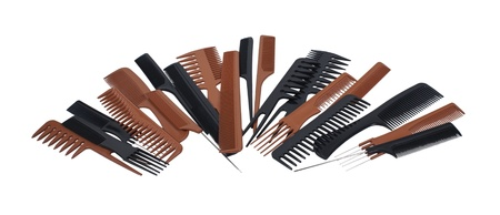 A jumbled variety of different styles of beautician combs for hair care and styling