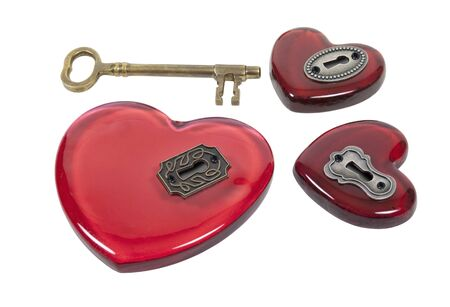 One key and several red glass hearts with antique locks to choose from  photo