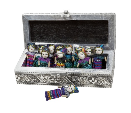 confide: Intricate silver box full of worry dolls.  Confide your troubles to the worry dolls at night to have a good nights sleep - path included Stock Photo