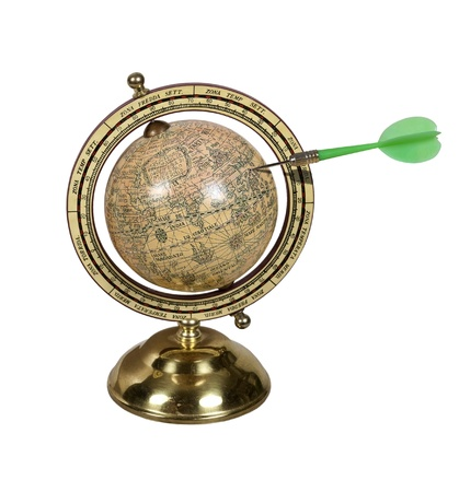 Old world globe with basic navigation notations with a dart marking a point Stock Photo - 10280879