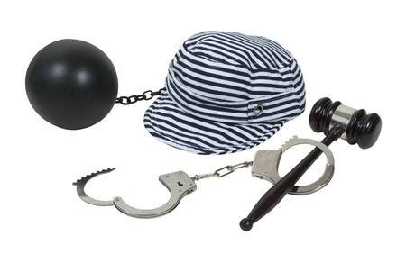 jailbird: Laws and consequences shown by a gavel and handcuffs with a jailbird hat and ball and chain