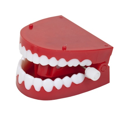 Humorous fake chattering teeth with red gums and white teeth - path included