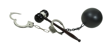 impede: Crime, legal process and consequence shown by a pair of hancuffs, a gavel and a ball and chain - path included Stock Photo