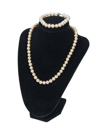 Pearl necklace and bracelet on a black velvet neck mold is an affordable luxury - path included Stock Photo - 10541822