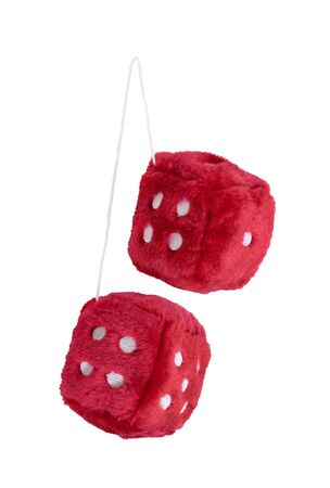 Red fuzzy dice with white dots that are usually hung from the rear view mirror of a car - path included Stock Photo