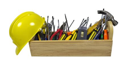 Yellow hard hat and long wooden toolbox full of tools - path included photo