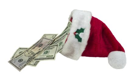 white trim: Money pouring from a traditional red Santa hat with white trim - path included