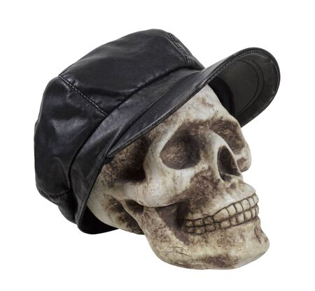 Skull wearing a leather driving cap worn on the head when out for a drive - path included