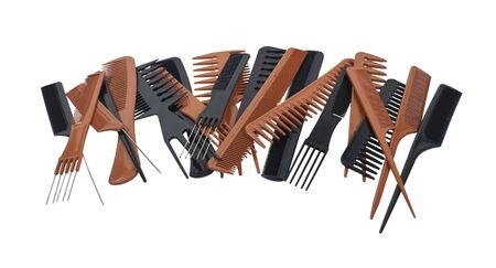 A variety of beautician combs for hair care and styling in a pile