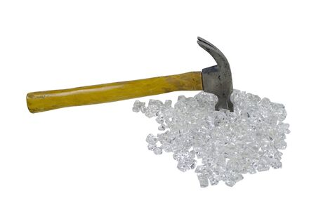 Hammer with a wooden handle used as a common household tool on a pile of broken glass - path included