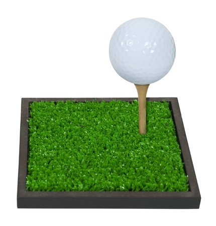 Golf Ball on a wooden Tee on Green Grass - path included