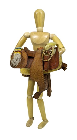 western saddle: Carrying a western saddle made of heavy tan leather for riding domestic horses - path included