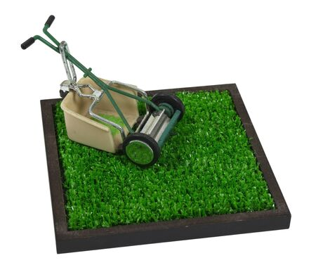 cut grass: Retro lawn mower with grass catcher on a section of grass - path included