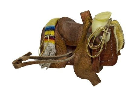 western saddle: Old western saddle made of heavy leather for riding domestic horses - path included Stock Photo